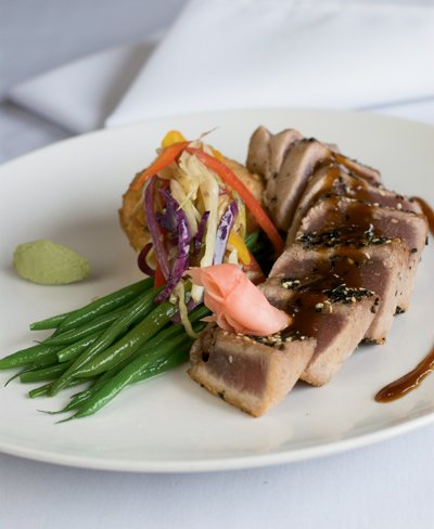 Seasame-seared tuna with tamarind sauce and asian slaw