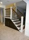 H002A38 - LL Staircase from the bottom with custom wine rack After.JPG