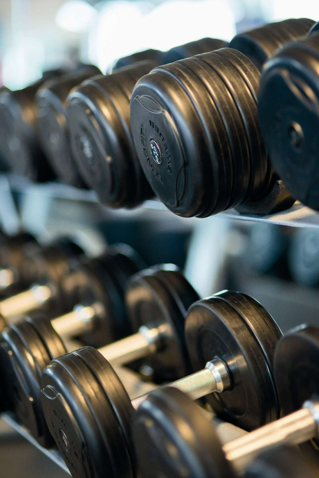 bodybuilding-close-up-dumbbells-equipment-260352.jpg