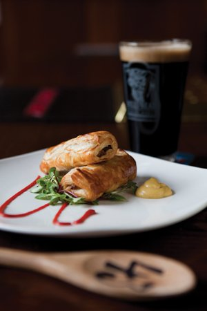 Bull's Head Public House: A few things you won't find anywhere else in the area: Harviestoun Old Engine Oil cask-conditioned ale with homemade sausage rolls wrapped in puff pastry and wooden paddles with order numbers on them